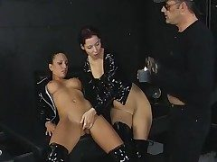 3some in the dungeon with dark-hued spandex damsels